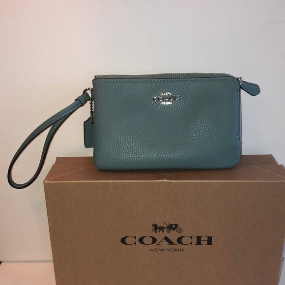 Coach Handbags - Coach leather wristlet with double pouch's. Blue
